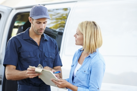 delivery driver: Customer Signing For Delivery From Courier