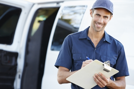 Portrait Of Delivery Driver With Clipboard photo