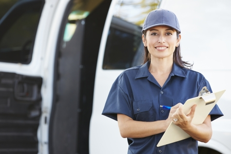 Portrait Of Female Delivery Driver With Clipboard photo