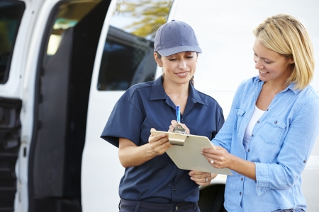 delivery driver: Customer Signing For Delivery From Female Courier
