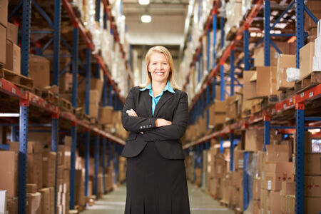 business management: Portrait Of Female Manager In Warehouse Stock Photo