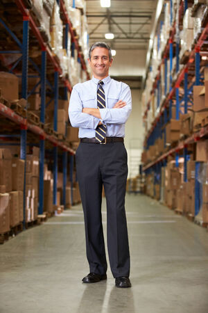 business shirt: Portrait Of Manager In Warehouse