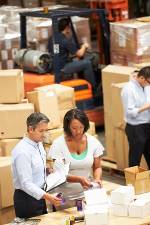 manager: Workers In Warehouse Preparing Goods For Dispatch