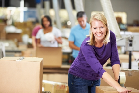 Workers In Warehouse Preparing Goods For Dispatch photo