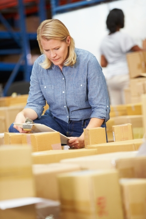 dispatch: Workers In Warehouse Preparing Goods For Dispatch