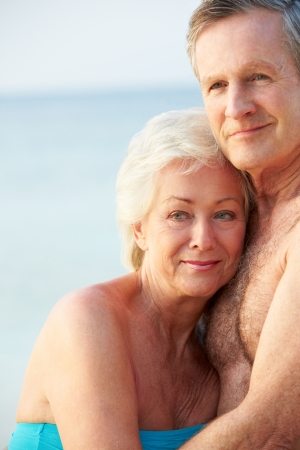 Portrait Of Romantic Senior Couple On Beach photo