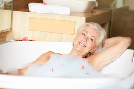 woman in bath: Senior Woman Relaxing In Bubble Bath Stock Photo
