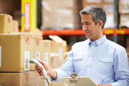 loading bay: Worker Scanning Package In Warehouse