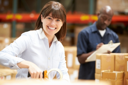 packing boxes: Workers In Warehouse Preparing Goods For Dispatch