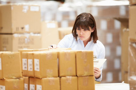 dispatch: Worker In Warehouse Preparing Goods For Dispatch Stock Photo