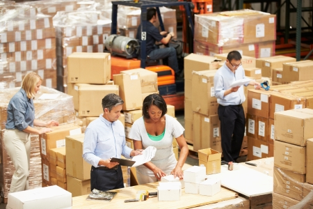 factory workers: Workers In Warehouse Preparing Goods For Dispatch