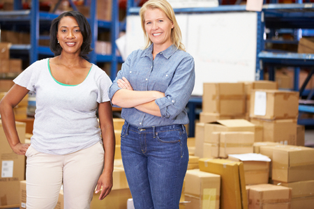 Portrait Of Workers In Distribution Warehouse photo