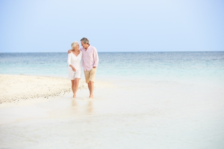 retired: Romantic Senior Couple Walking On Beautiful Tropical Beach
