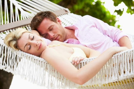 Couple Sleeping In Beach Hammock photo