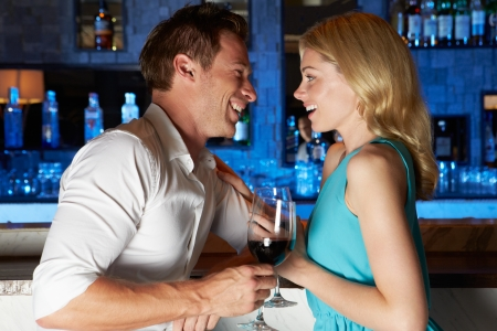 Couple Enjoying Drink In Bar photo