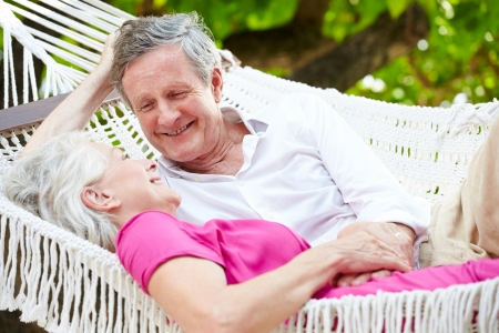 Senior Couple Relaxing In Beach Hammock photo
