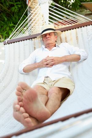 hammock beach: Senior Man Relaxing In Beach Hammock