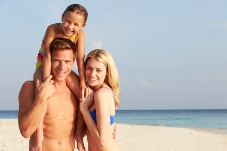 Portrait Of Family On Tropical Beach Holiday photo