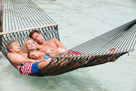 Family Relaxing In Beach Hammock photo