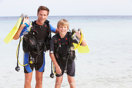 watersport: Father And Son With Scuba Diving Equipment On Beach Holiday