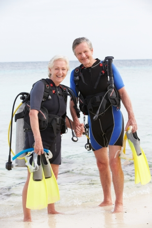 watersports: Senior Couple With Scuba Diving Equipment Enjoying Holiday