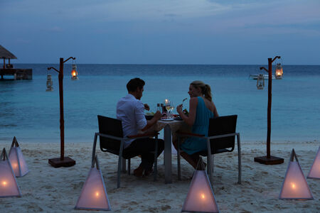 Couple Enjoying Late Meal In Outdoor Restaurant photo
