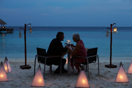 romantic evening with wine: Senior Couple Enjoying Late Meal In Outdoor Restaurant