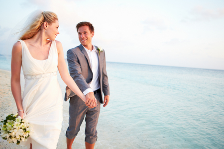 getting married: Bride And Groom Getting Married In Beach Ceremony