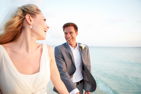 Bride And Groom Getting Married In Beach Ceremony photo