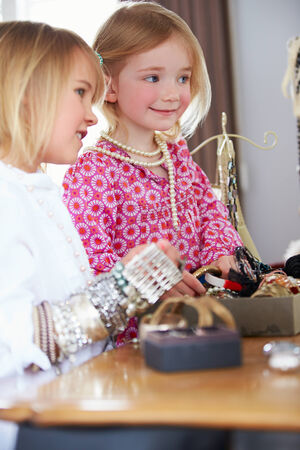 4 5 year old: Two Girls Playing With Jewelry And Make Up Stock Photo