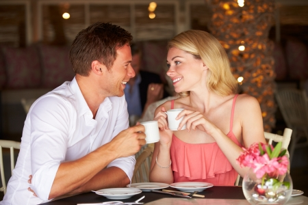 mealtime: Couple Enjoying Cup Of Coffee In Restaurant