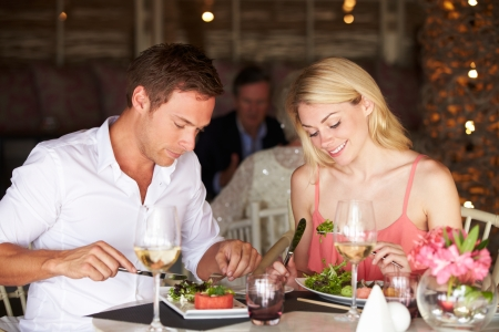couple dining: Couple Enjoying Meal In Restaurant Stock Photo