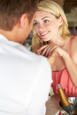 proposal of marriage: Man Proposing To Woman In Restaurant