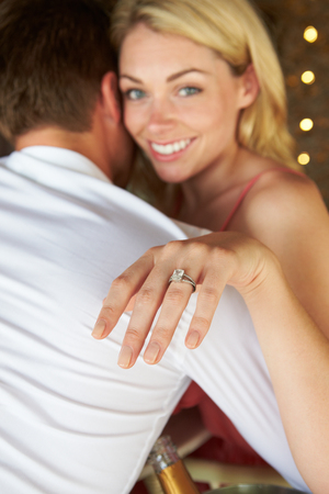 Man Proposing To Woman In Restaurant photo