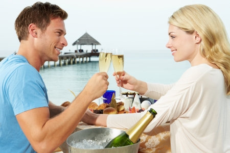 seafront: Couple Enjoying Meal In Seafront Restaurant