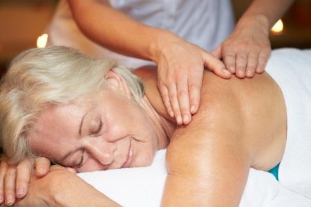 therapist: Senior Woman Having Massage In Spa