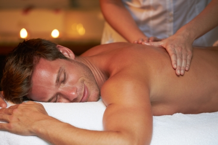 spa treatment: Man Having Massage In Spa