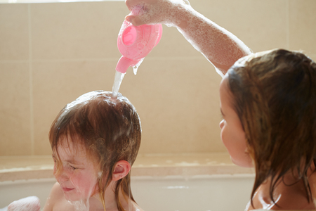 4 5 year old: Two Girls Sharing Bubble Bath And Washing Hair