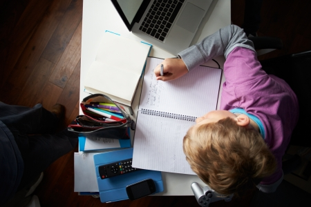Overhead View Of Boy Studying In Bedroom Stock Photo - 24493965