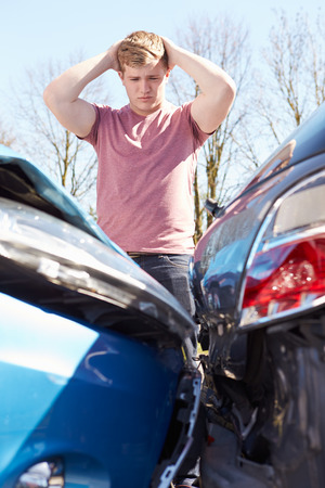 car wreck: Driver Inspecting Damage After Traffic Accident Stock Photo