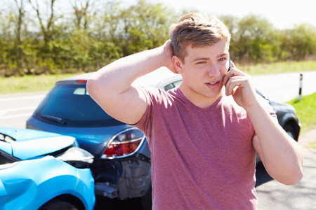 accident damage: Driver Making Phone Call After Traffic Accident