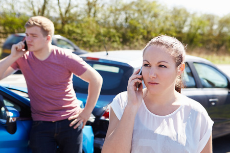 auto accident: Driver Making Phone Call After Traffic Accident