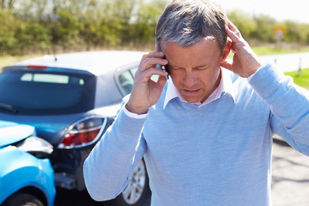 accident car: Driver Making Phone Call After Traffic Accident