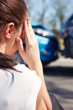 accident damage: Stressed Driver Sitting At Roadside After Traffic Accident