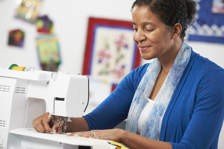 Woman Using Electric Sewing Machine