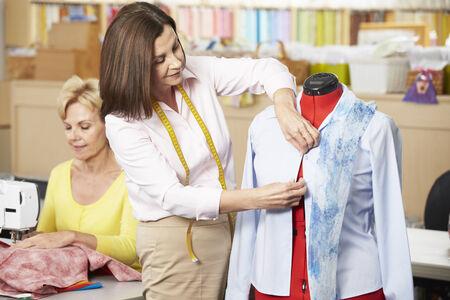 stitching machine: Women In Dress Making Class Stock Photo