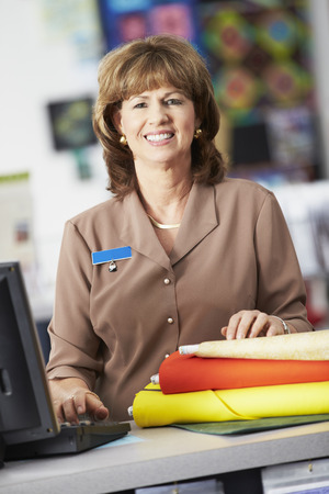 Portrait Of Female Cashier At Clothing Store