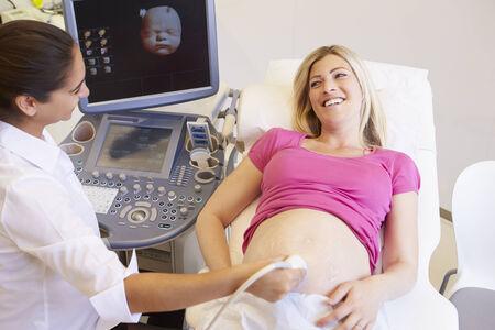 Pregnant Woman Having 4D Ultrasound Scan photo