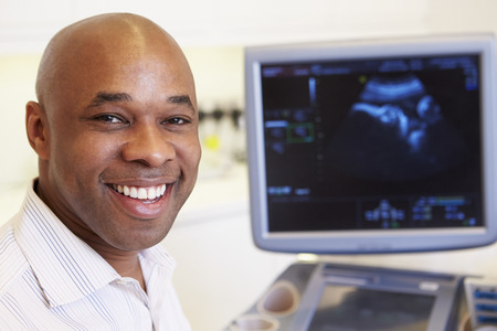screen: Portrait Of 4D Ultrasound Scanning Machine Operator Stock Photo