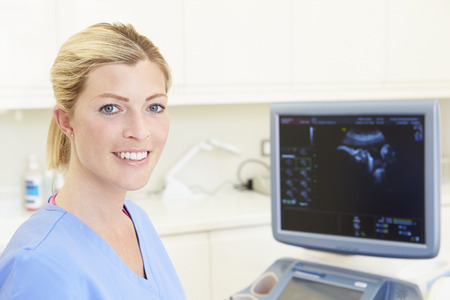 Portrait Of 4D Ultrasound Scanning Machine Operator Stock Photo
